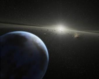 Immagine artistica di un sistema planetario visto di taglio, con polveri e detriti in evidenza. Crediti: Image credit: Nasa-Jpl / Caltech / T. Pyle (Ssc)