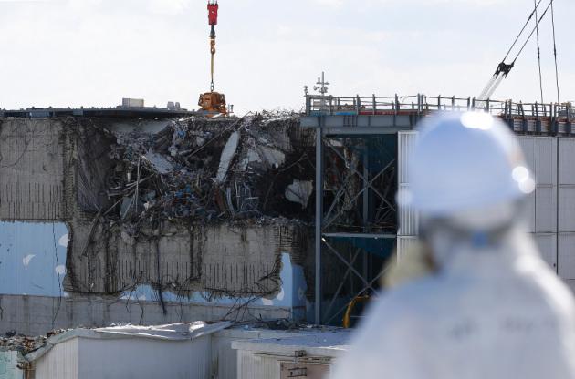 La centrale di Fukushima Dai-chi (nella foto i resti accartocciati del reattore 3, interessato da un'esplosione).|REUTERS/TORU HANAI