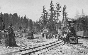 Da est a ovest: una stazione sulle montagne rocciose, nel 1900. Già dal 1869 si poteva attraversare l'America in treno. | akg/mondadori