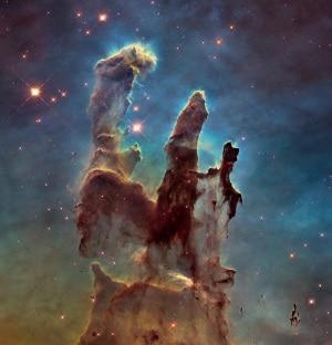 I pilastri della Creazione. Sono nubi di gas e polveri cosmiche nella Nebulosa Aquila (M16), a 6500 anni luce da noi. Vedi anche:I Pilastri della Creazione, 20 anni dopo| NASA/ESA/HUBBLE HERITAGE TEAM