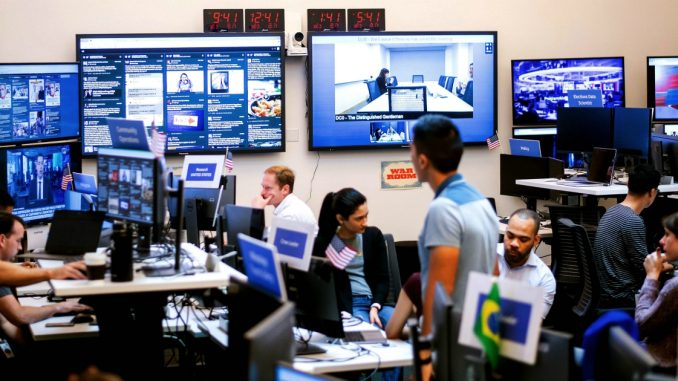 """Employees work in Facebook's """"War Room,"""" during a media demonstration on October 17, 2018, in Menlo Park, California. - The freshly launched unit at Facebook's Menlo Park headquarters is the nerve center for the fight against misinformation and manipulation of the largest social network by foreign actors trying to influence elections in the United States and elsewhere. The war room, which will ramp up activity for the November 6 midterm US elections, is the most concrete sign of Facebook's efforts to weed out misinformation. (Photo by NOAH BERGER / AFP)"""