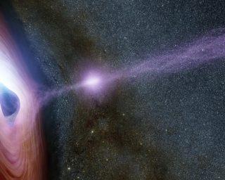 Un buco nero supermassiccio circondato da un disco rotante di materiale, in un'elaborazione artistica. | NASA/JPL-Caltech