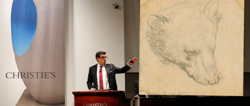 "Auctioneer Andreas Rumbler takes bids on Monet's ""Water Lilys,"" during Christie's Impressionist and Modern Art spring sale Thursday, May 12, 2016, in New York. A Frida Kahlo painting broke the world auction record for the artist, but also for any Latin American artist sold at auction. (AP Photo/Kathy Willens)"